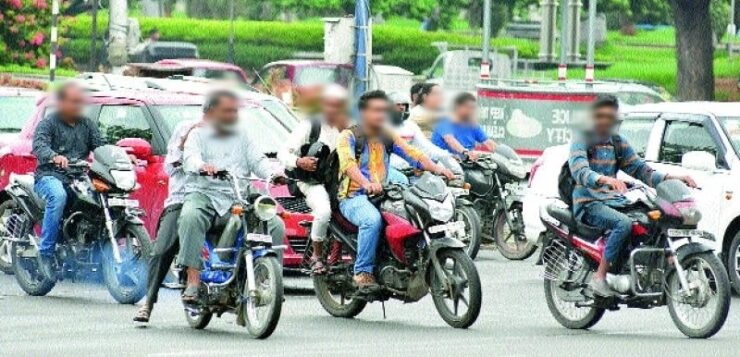 File Pic: Two-wheeler motorist at Traffic Stop in India.